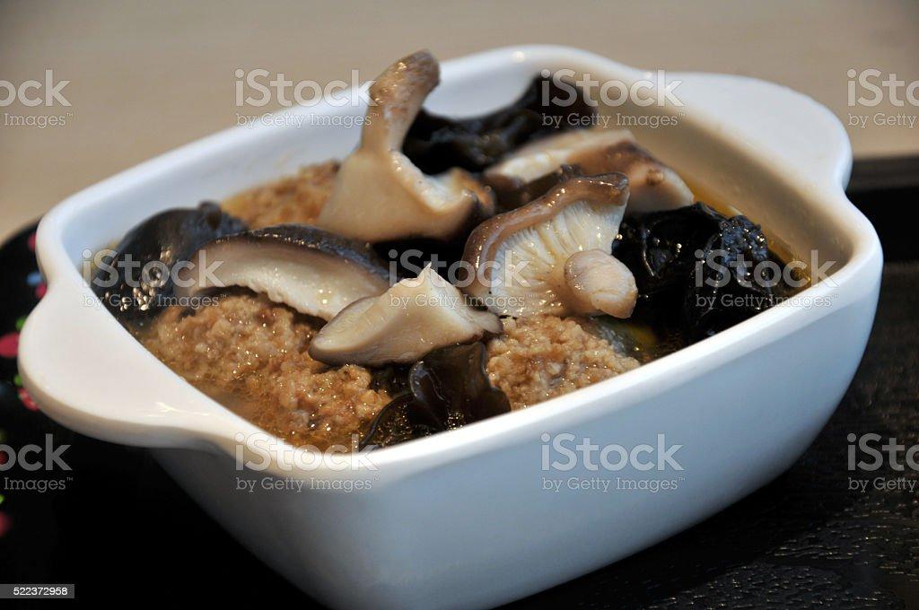 Bowl of chinese soup with pork balls, shiitake mushrooms stock photo