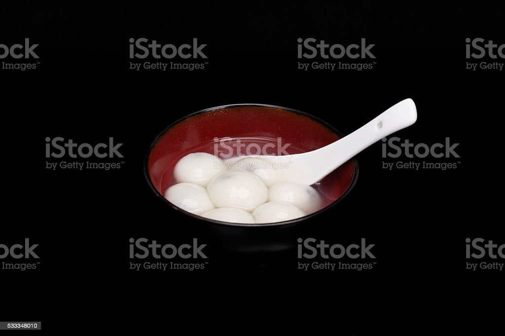 bowl of Chinese Tangyuan in black background stock photo