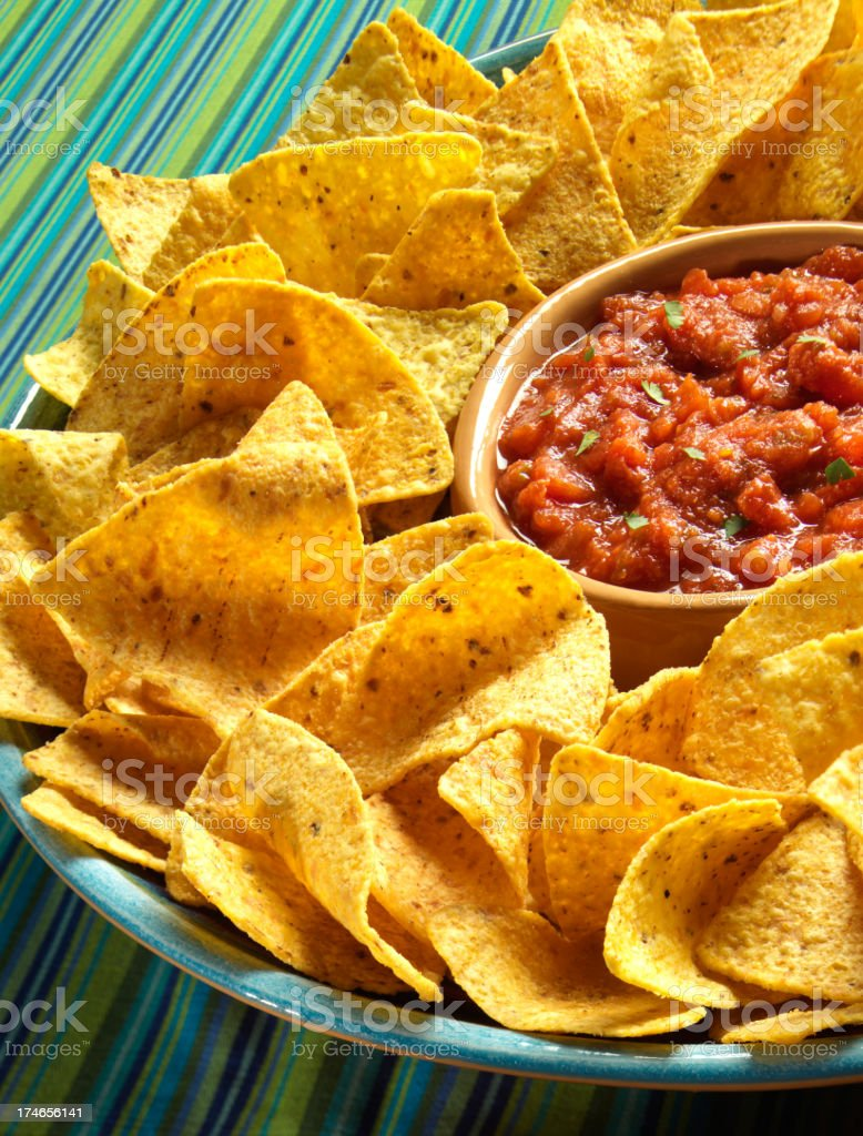 bowl of chips with fresh salsa stock photo
