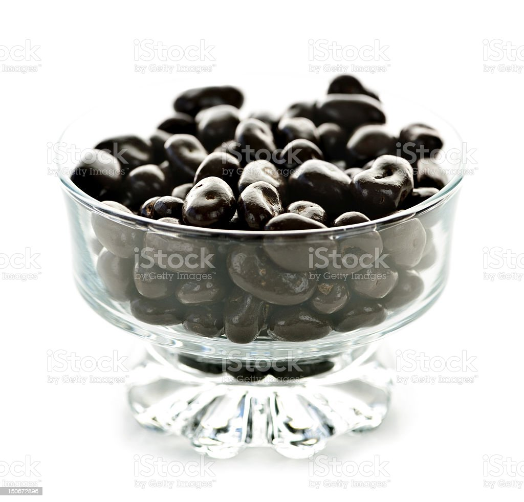 Bowl of chocolate coated cranberries or raisins stock photo