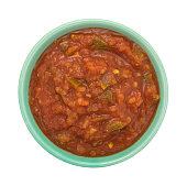 Bowl of chunky salsa sauce on a white background