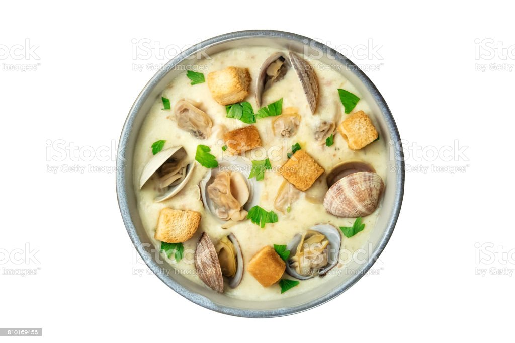 Bowl of clam chowder soup, overhead shot, isolated stock photo
