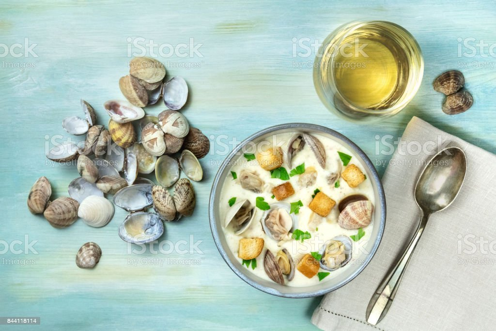 Bowl of clam chowder soup, overhead shot, with copy space stock photo