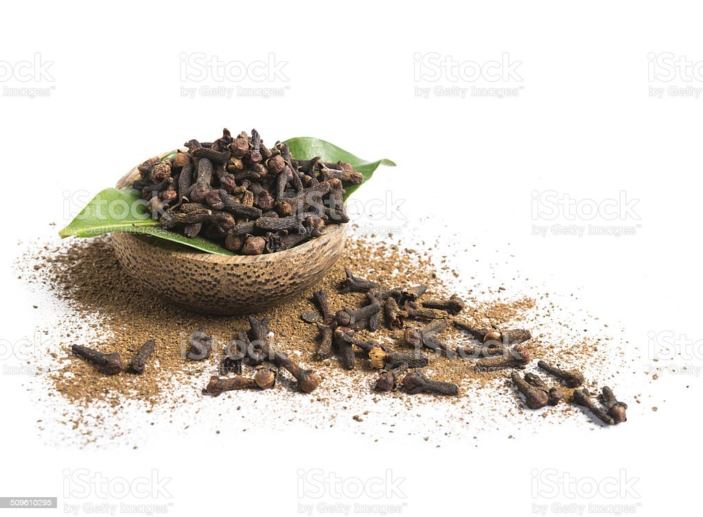 Bowl of clove isolated on white stock photo