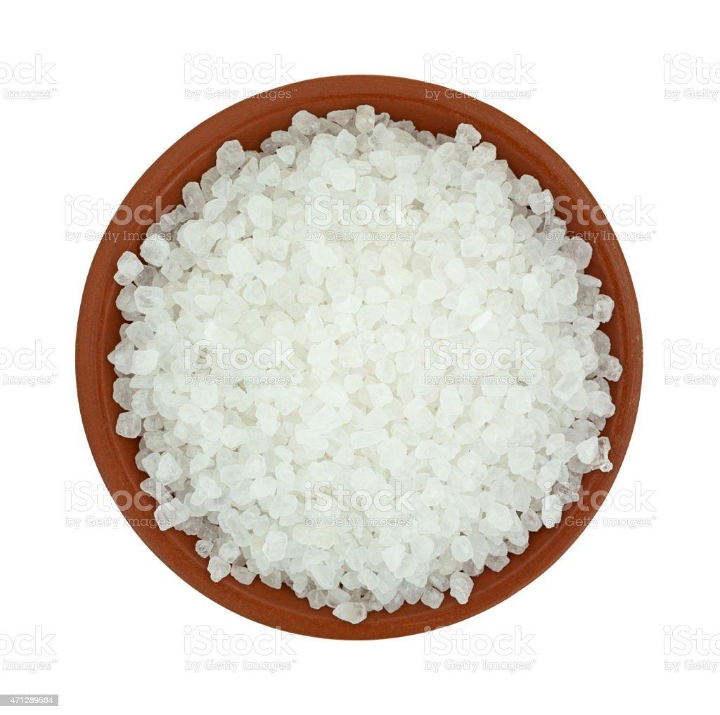 Bowl of coarse sea salt stock photo