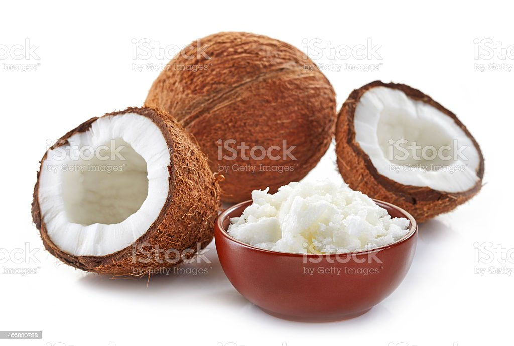 bowl of coconut oil and fresh coconuts stock photo