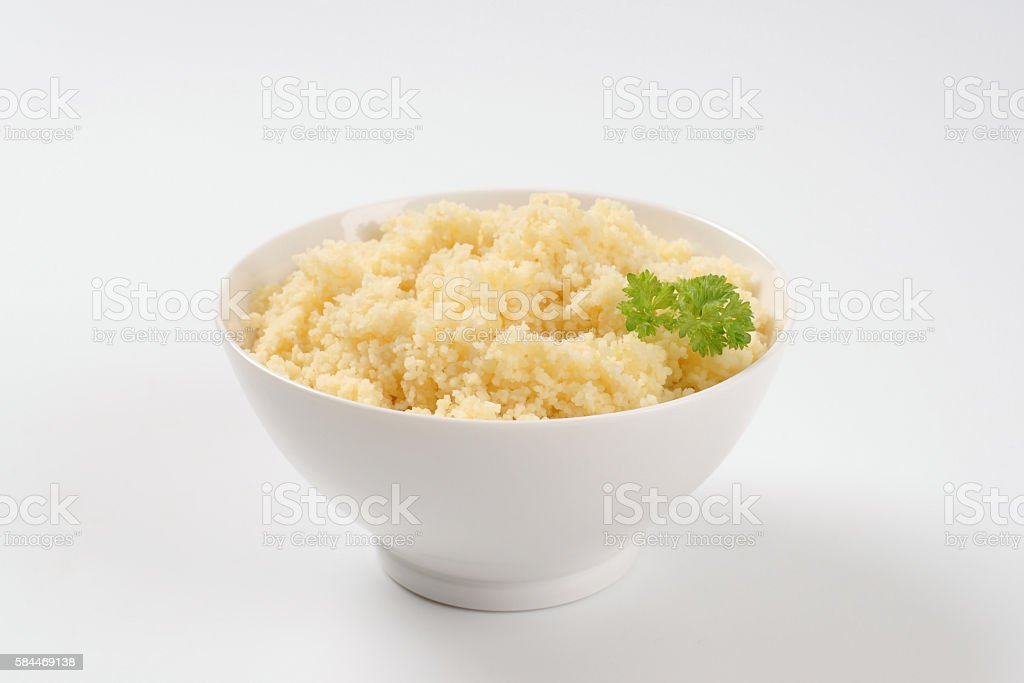 bowl of cooked couscous stock photo