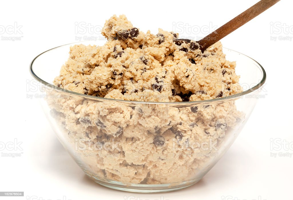 Bowl of cookie dough with a wooden spoon and chocolate chips royalty-free stock photo