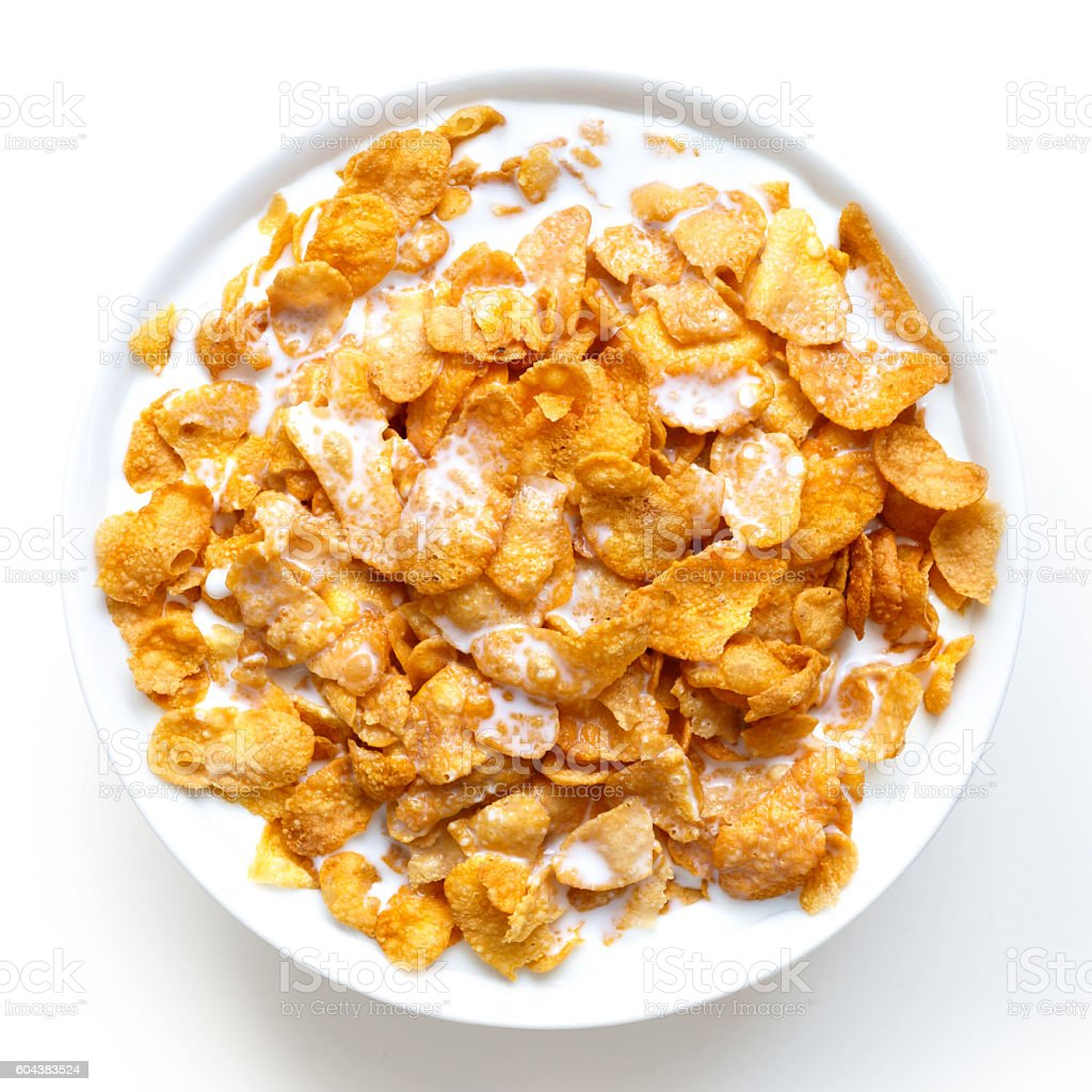 Bowl of cornflakes in milk isolated on white from above. stock photo