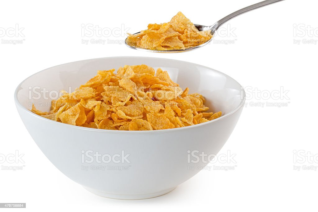 bowl of cornflakes with a spoon stock photo