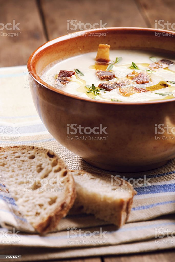 Bowl of cream soup on wooden table royalty-free stock photo