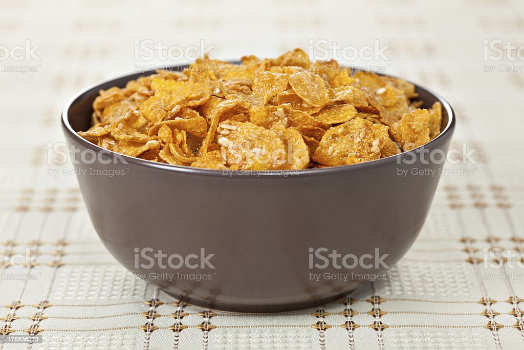 Bowl of crunchy nuts corn flakes for breakfast royalty-free stock photo