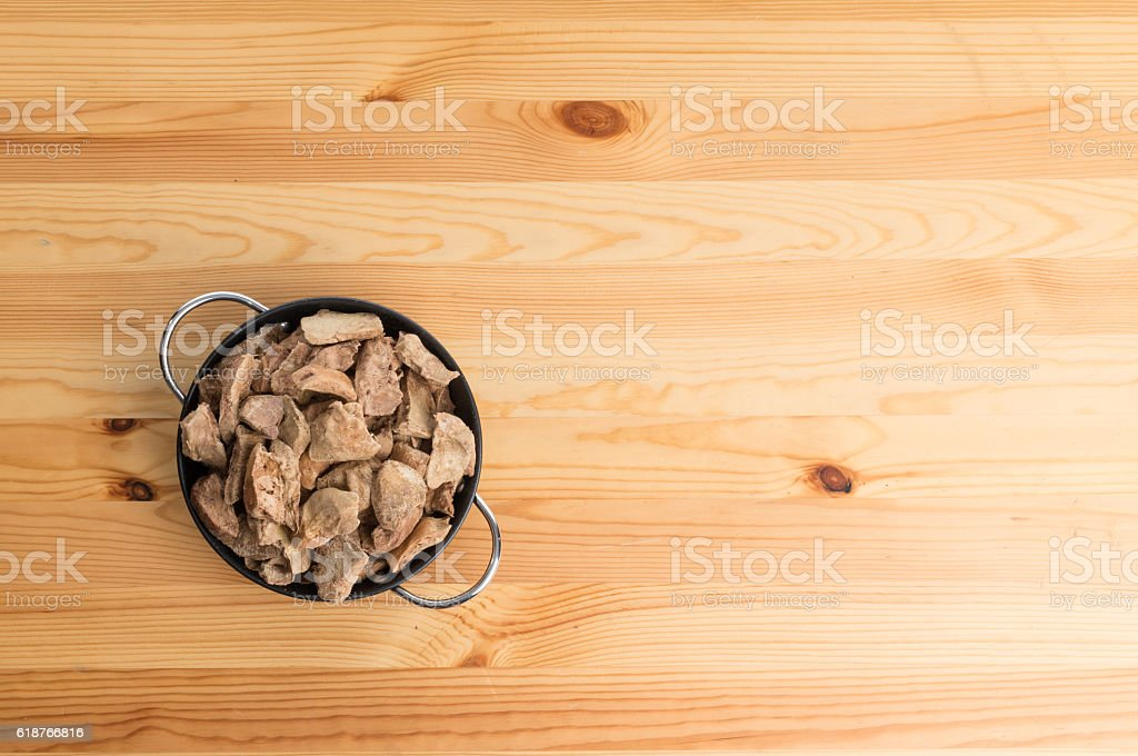 bowl of dog treat on wood table stock photo