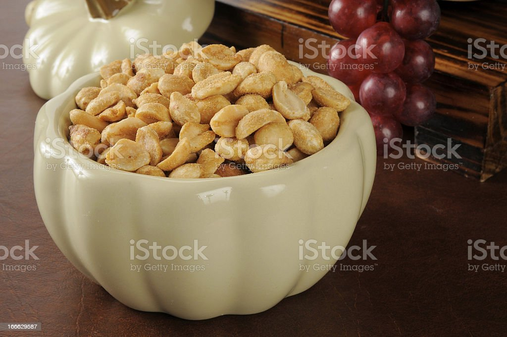 Bowl of dry roasted peanuts royalty-free stock photo