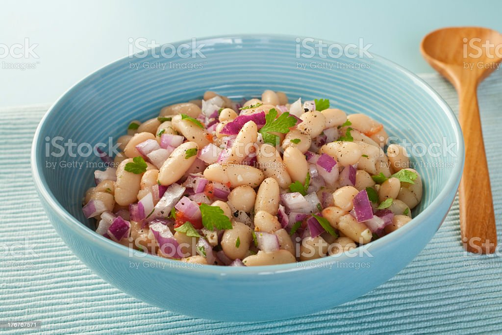 Bowl of fresh bean salad with purple onion royalty-free stock photo
