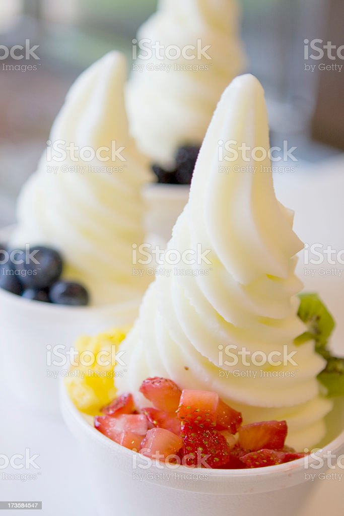 A bowl of fresh fruit with ice cream stock photo