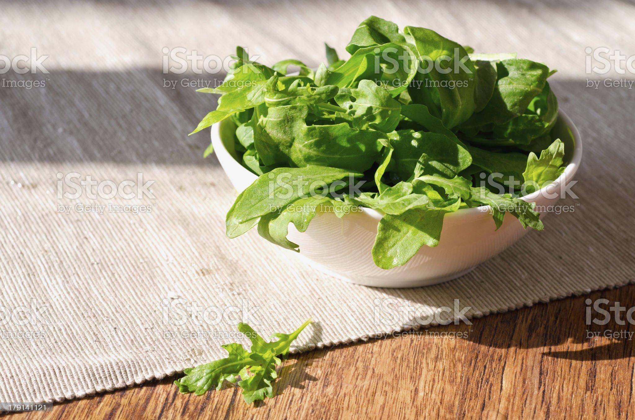 bowl of fresh green, natural arugula royalty-free stock photo