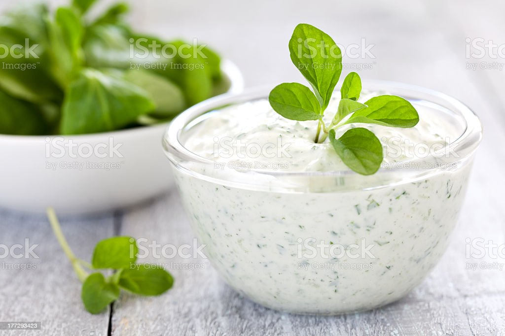 Bowl of fresh quark with herbs stock photo