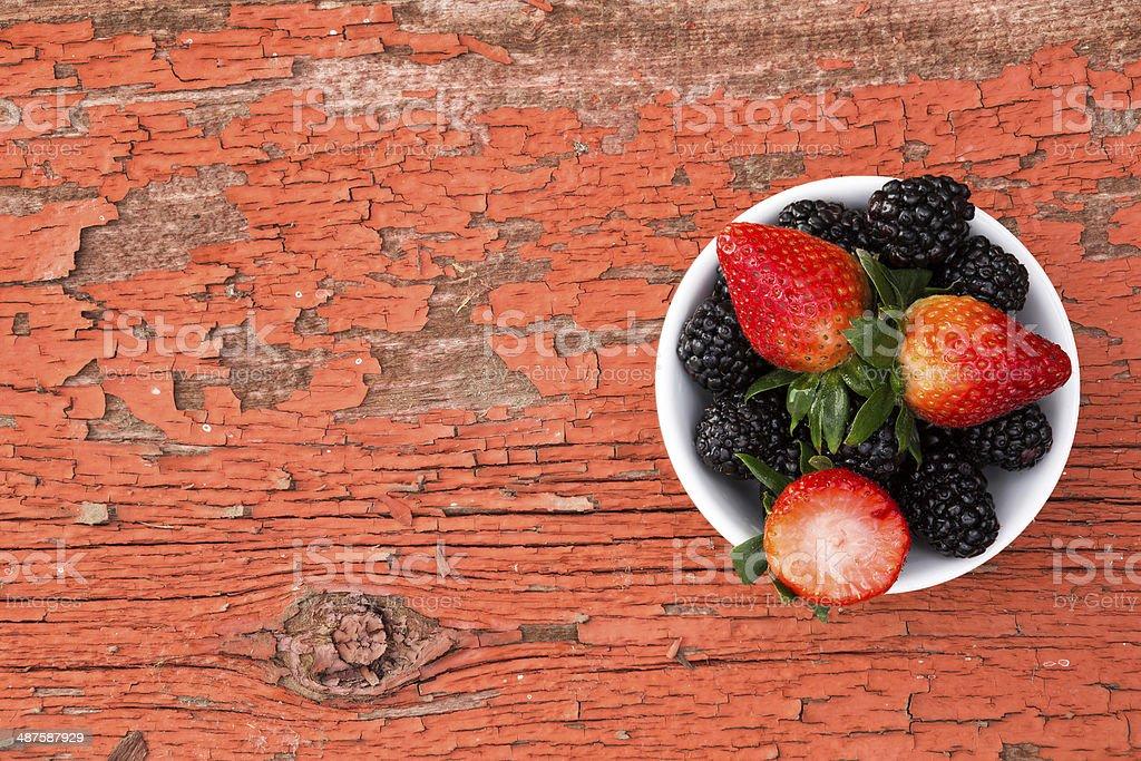 Bowl of fresh ripe mixed berries stock photo