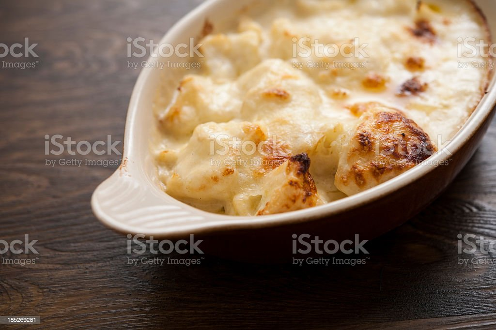 Bowl of freshly baked Cauliflower Cheese royalty-free stock photo