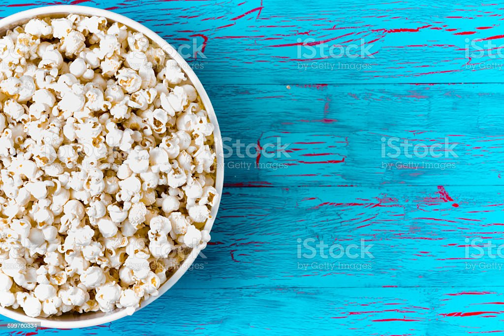 Bowl of freshly made popcorn on a picnic table stock photo