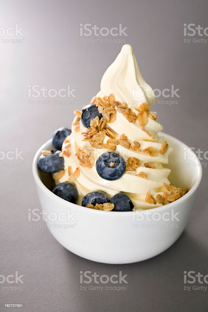 Bowl of frozen yogurt with blueberries and granola stock photo