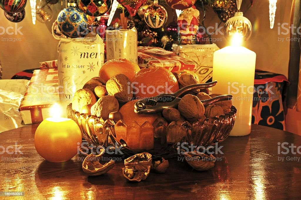 Bowl of fruit and Christmas Presents. royalty-free stock photo