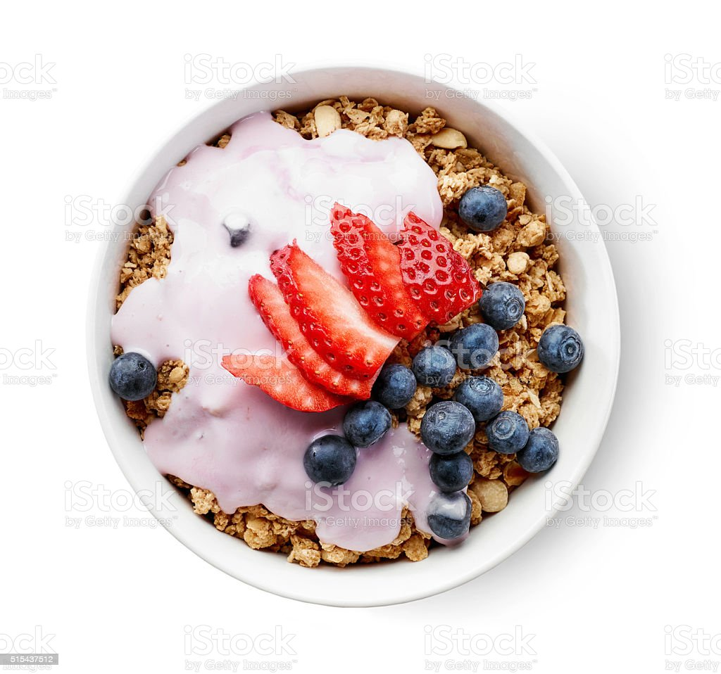 bowl of granola with yogurt and berries stock photo
