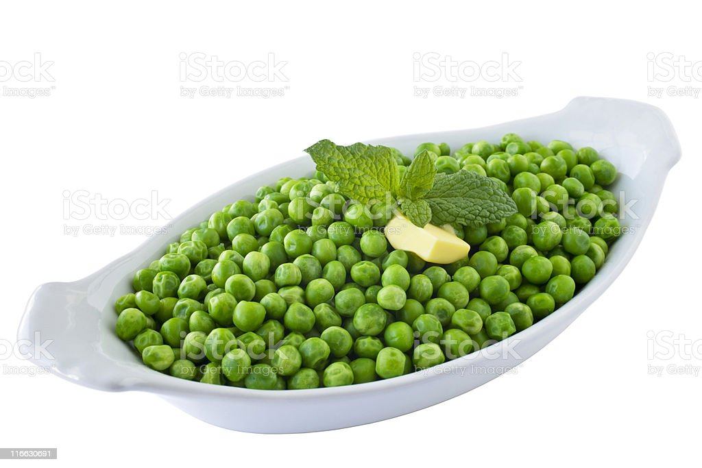 Bowl of Green Peas with Mint and Butter on White stock photo