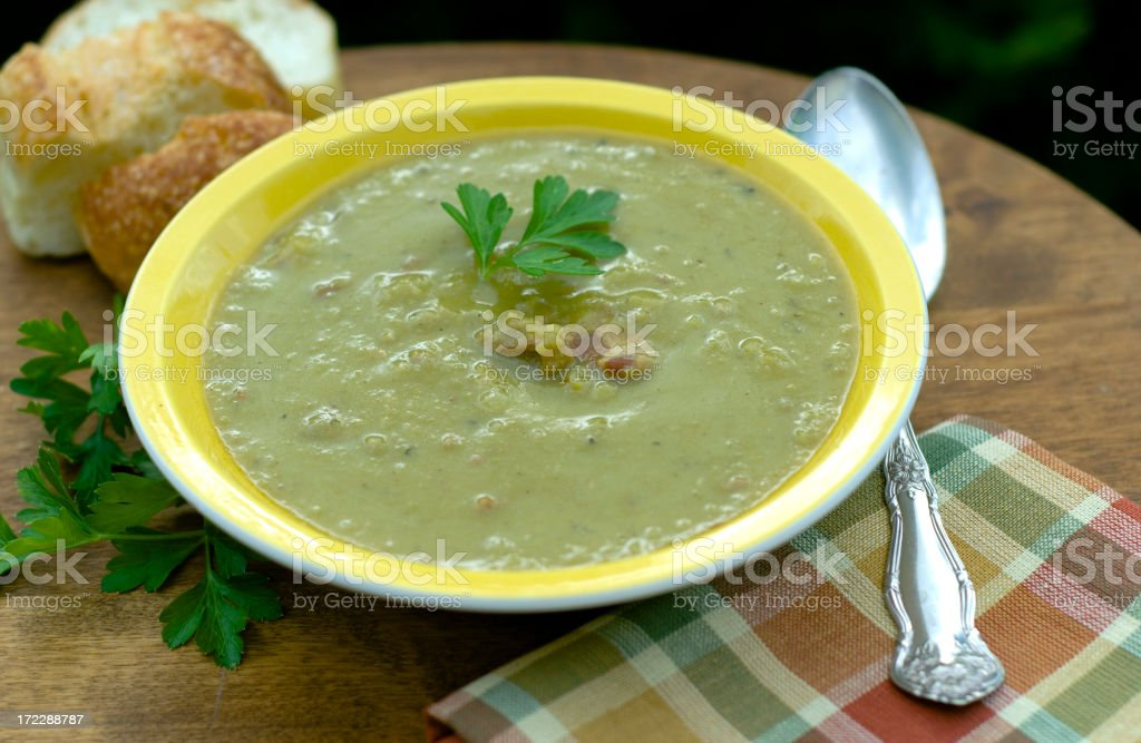 Bowl of Green Split Pea Vegetable & Ham Soup, Winter Food stock photo