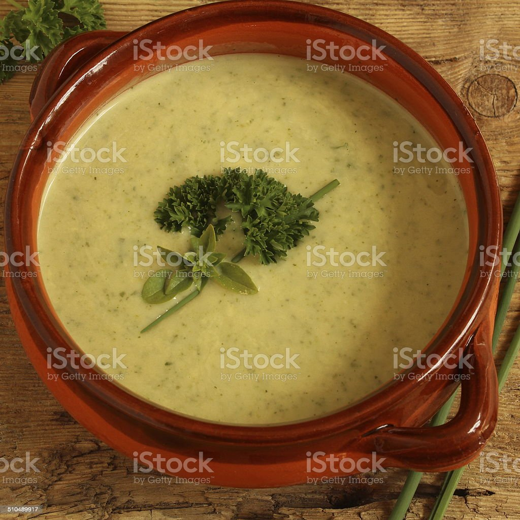 bowl of healthy herbs soup stock photo