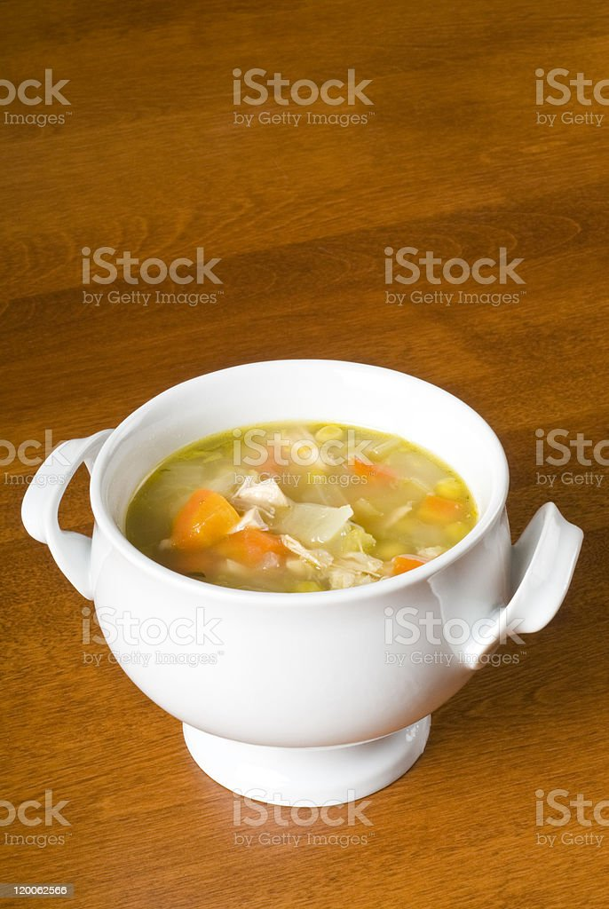 Bowl of Homemade Chicken Soup with Vegetables stock photo