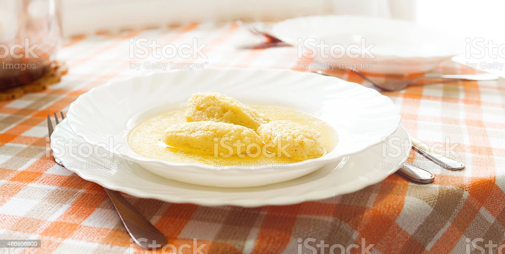 Bowl of homemade soup on the table stock photo