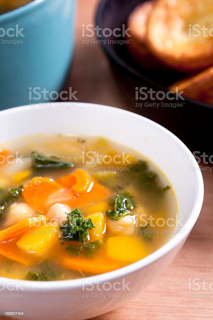 Bowl of hot and fresh vegetable soup stock photo
