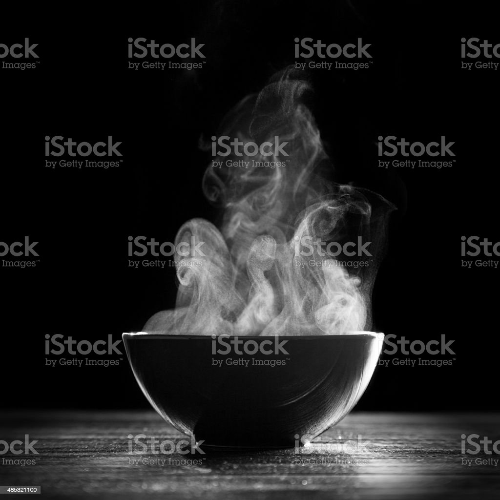Bowl of hot soup stock photo