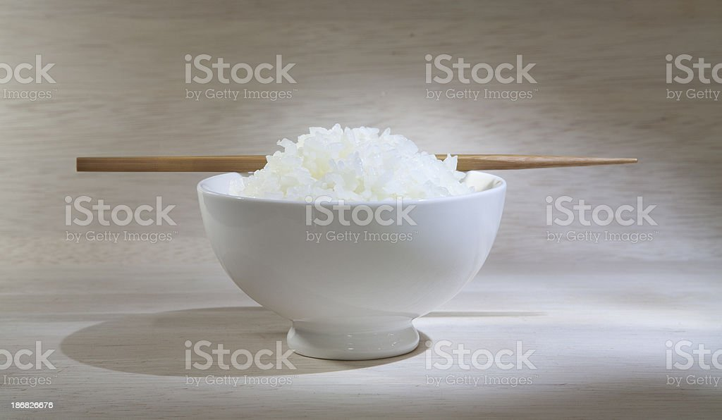 Bowl of Japanese rice with chopsticks stock photo