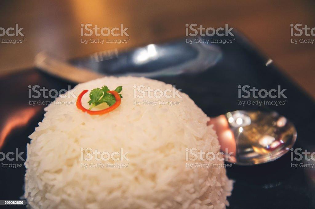 Bowl of Jasmine rice on a plate - Thai Staple Food stock photo