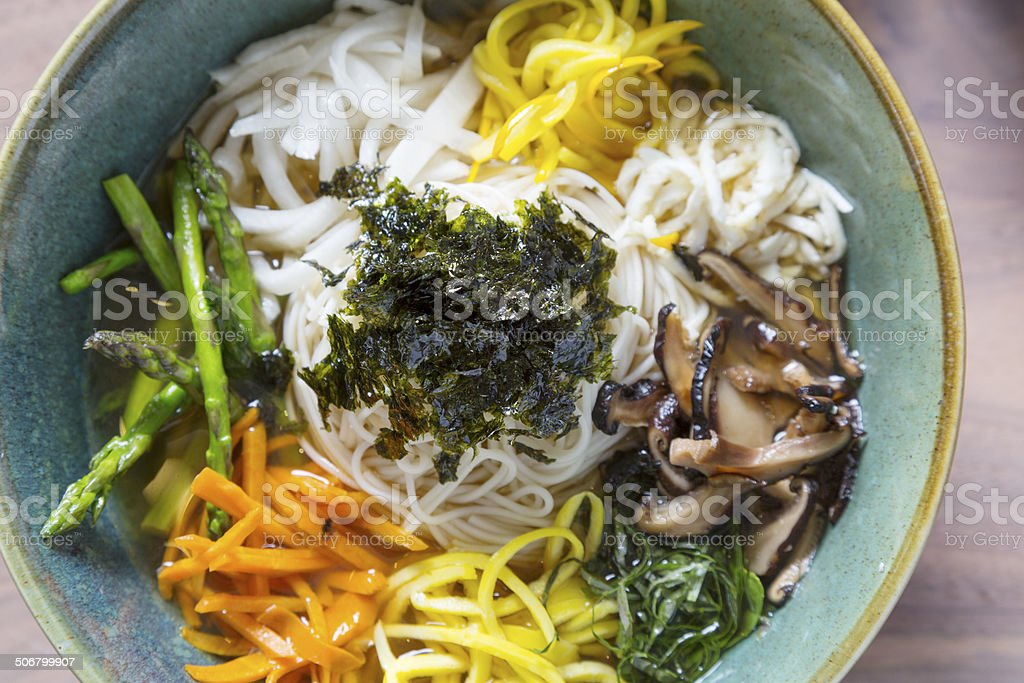 Bowl of Korean Style Noodle soup with fresh vegetables royalty-free stock photo