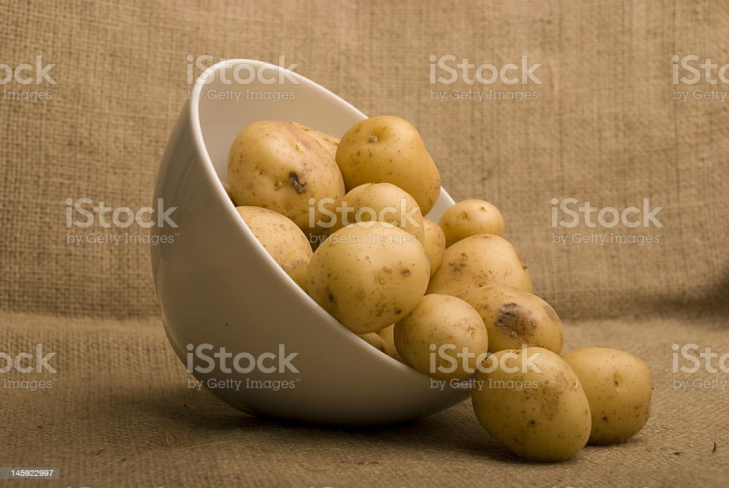 bowl of m peer potatoes on sack royalty-free stock photo