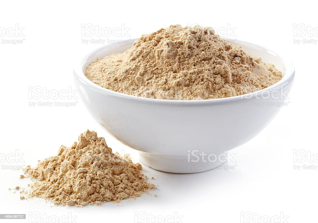 bowl of maca powder stock photo