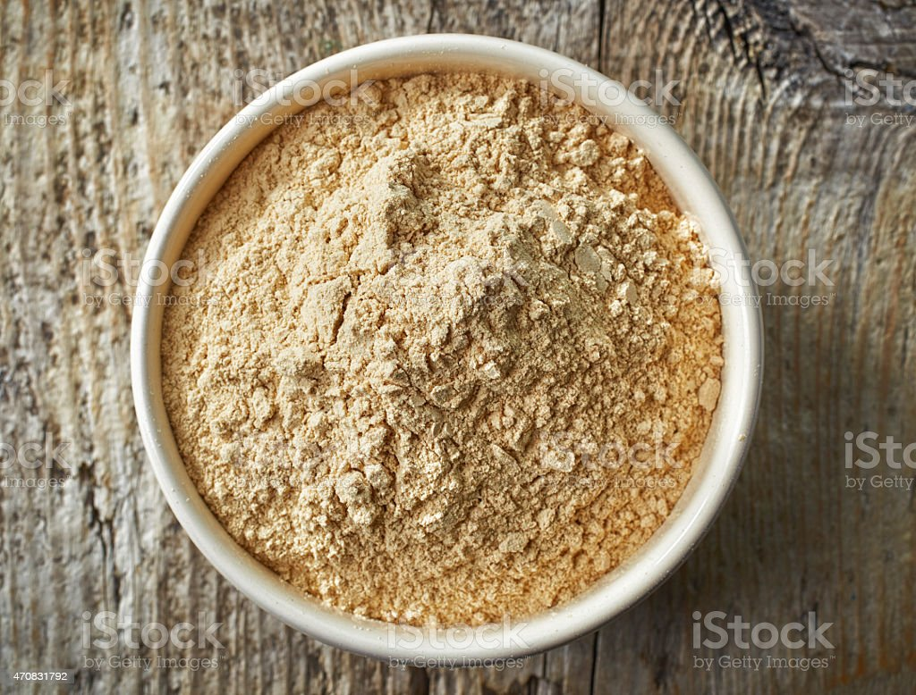 bowl of maca powder stock photo