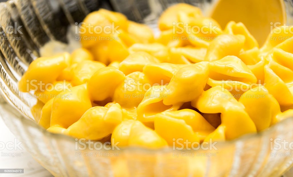Bowl of Macaroni Shells and Cheese stock photo