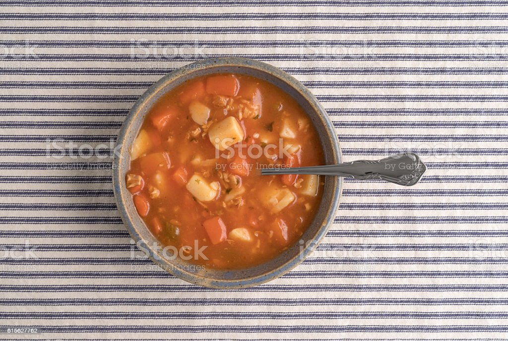 Bowl of Manhattan style clam chowder with spoon stock photo