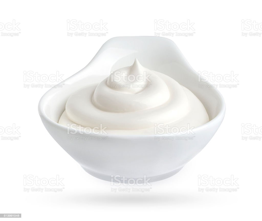 Bowl of mayonnaise isolated on white background stock photo