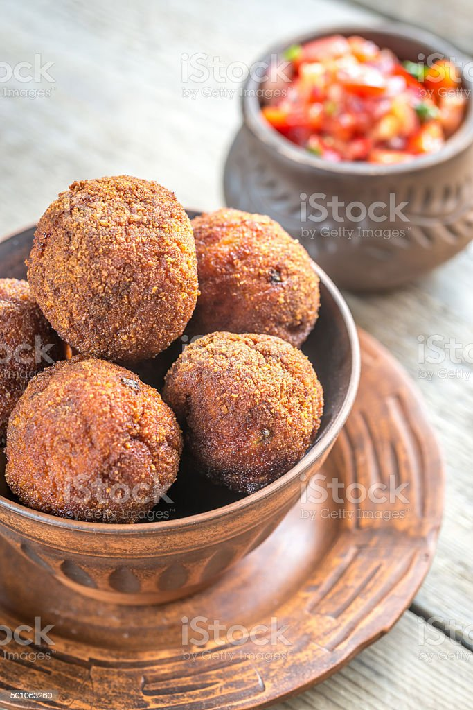 Bowl of meatballs with mexican sauce salsa stock photo