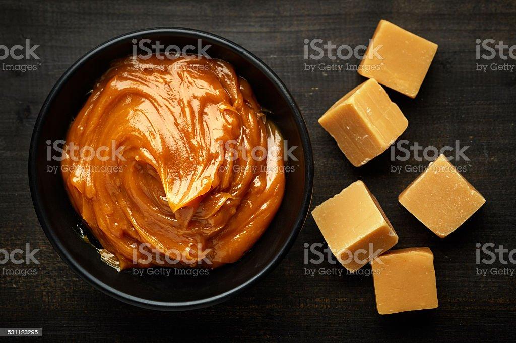 Bowl of melted caramel cream stock photo