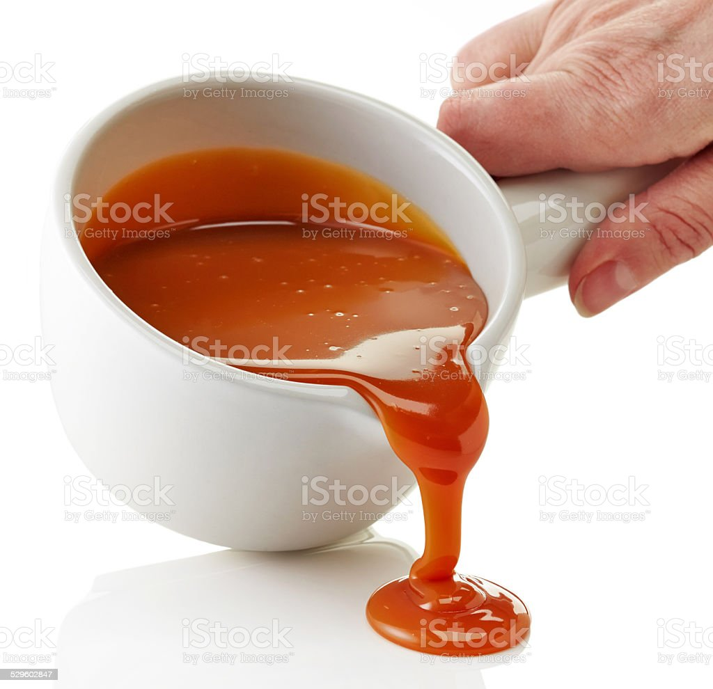 bowl of melted caramel sauce stock photo