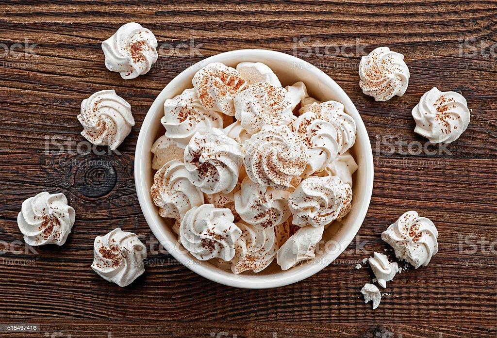 bowl of meringue cookies stock photo