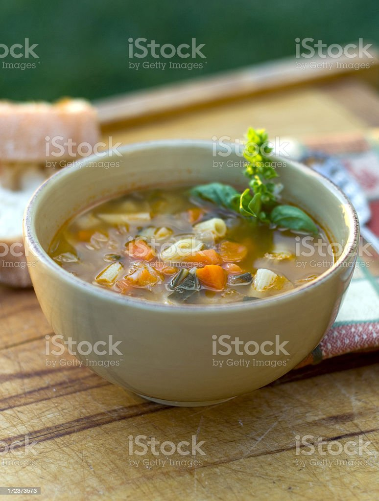 Bowl of Minestrone Italian Soup, Winter Vegetarian Vegetable Noodle Stew stock photo