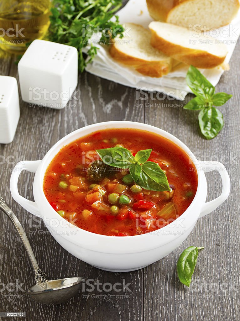 Bowl of minestrone soup with bread royalty-free stock photo